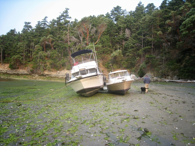 A windstorm our last night camping blew both boats up on the beach.